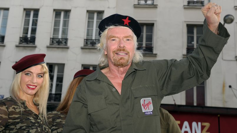 British billionaire Richard Branson arrives aboard a jeep to attend a press conference by French telecom company Virgin Mobile for the presentation of Virgin Mobile's new offer Telib in Paris on September 18, 2013. AFP PHOTO ERIC PIERMONT